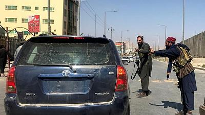 Taliban impose some order around Kabul airport - witnesses