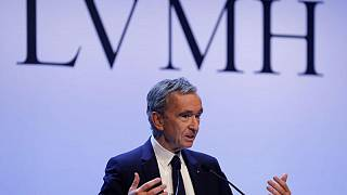 Luxury billionaire Arnault sells out of retailer Carrefour