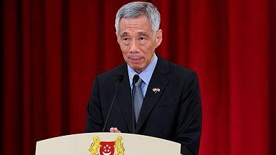 Singapore PM wins more defamation suits against bloggers