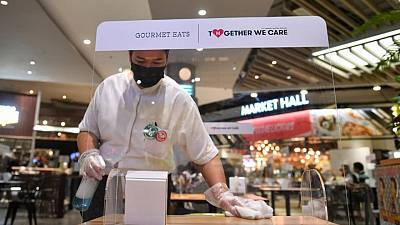 Hair cuts and dining in as Thai malls reopen after virus cases ease