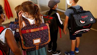 Facemasks and sanitizer as French kids go back to school