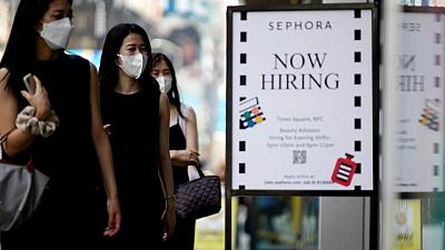 Soaring COVID-19 infections restrain U.S. job gains in August