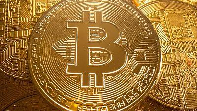 Bitcoin rises back above $50,000