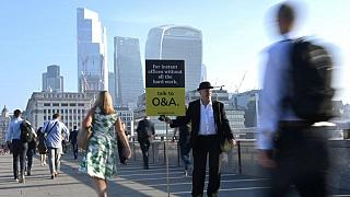 London's financial workers flock back to office in hot commuter crush