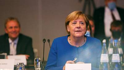 Missing Merkel already, Germans nervous about what comes next