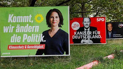 German leadership hopefuls clash on TV over money-laundering raids, far-left