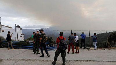 Las lluvias ayudan a controlar un devastador incendio en España
