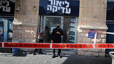 Palestinian stabs two in Jerusalem shop before being shot, Israeli police say