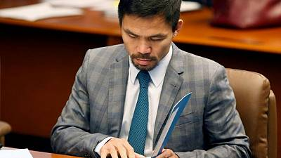 Philippines' Pacquiao sues influential evangelist over graft accusation