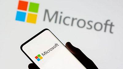 Microsoft shares edge higher on $60 billion buyback program