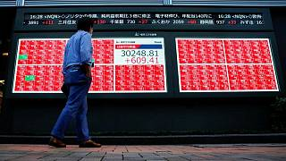 Asian shares rise on stronger global risk appetite as oil prices ease