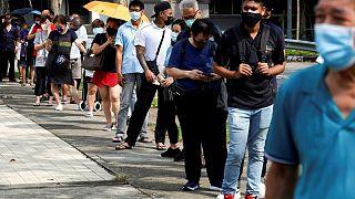 Singapore reviewing complex COVID-19 protocols