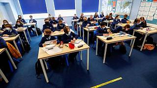 English school return spurred COVID in children, but cases fell in adults - study